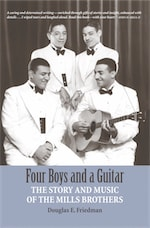 FOUR BOYS AND A GUITAR: The Story and Music of The Mills Brothers by Douglas E. Friedman